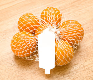 Oranges in a white netted bag